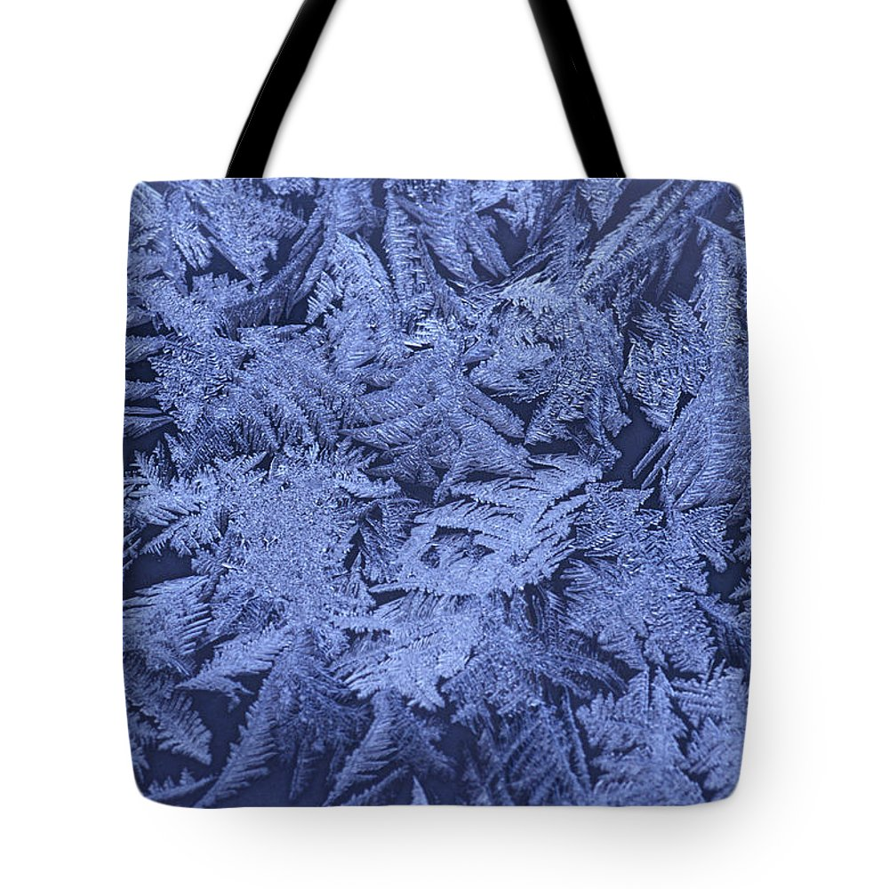 Ice Crystals Tote Bag featuring the photograph Frost On A Window by Richard Nowitz
