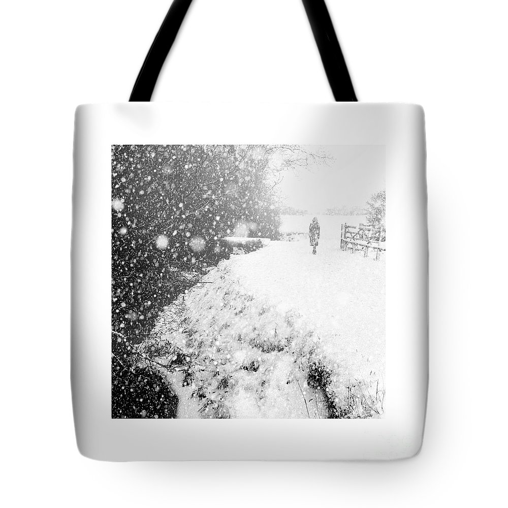 Frozen Moments Tote Bag featuring the photograph Frozen Moments - Walking Away by Paul Davenport