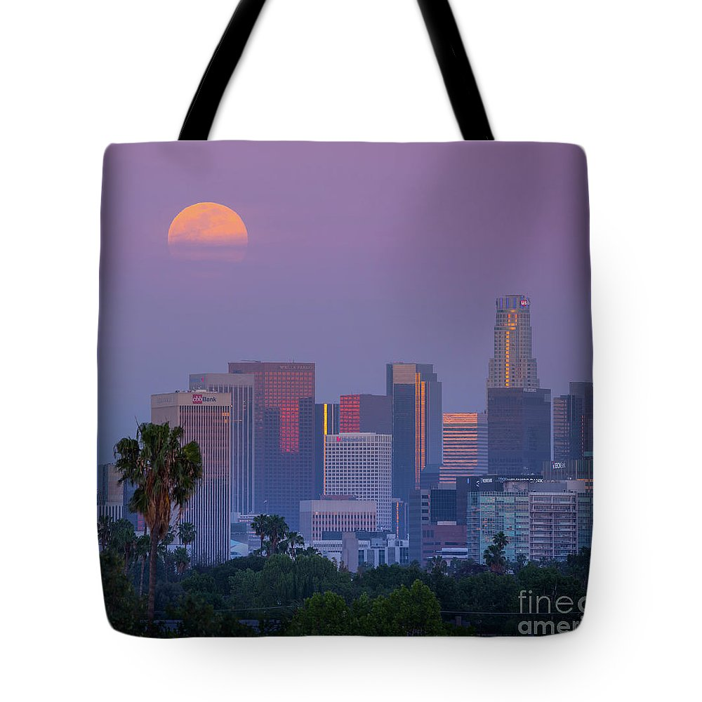 Los Tote Bag featuring the photograph Full Moon Rising Over Downtown Los Angeles Skyline by Konstantin Sutyagin