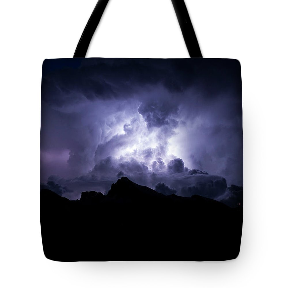 Fury Tote Bag featuring the photograph Furious by Marc Wieland