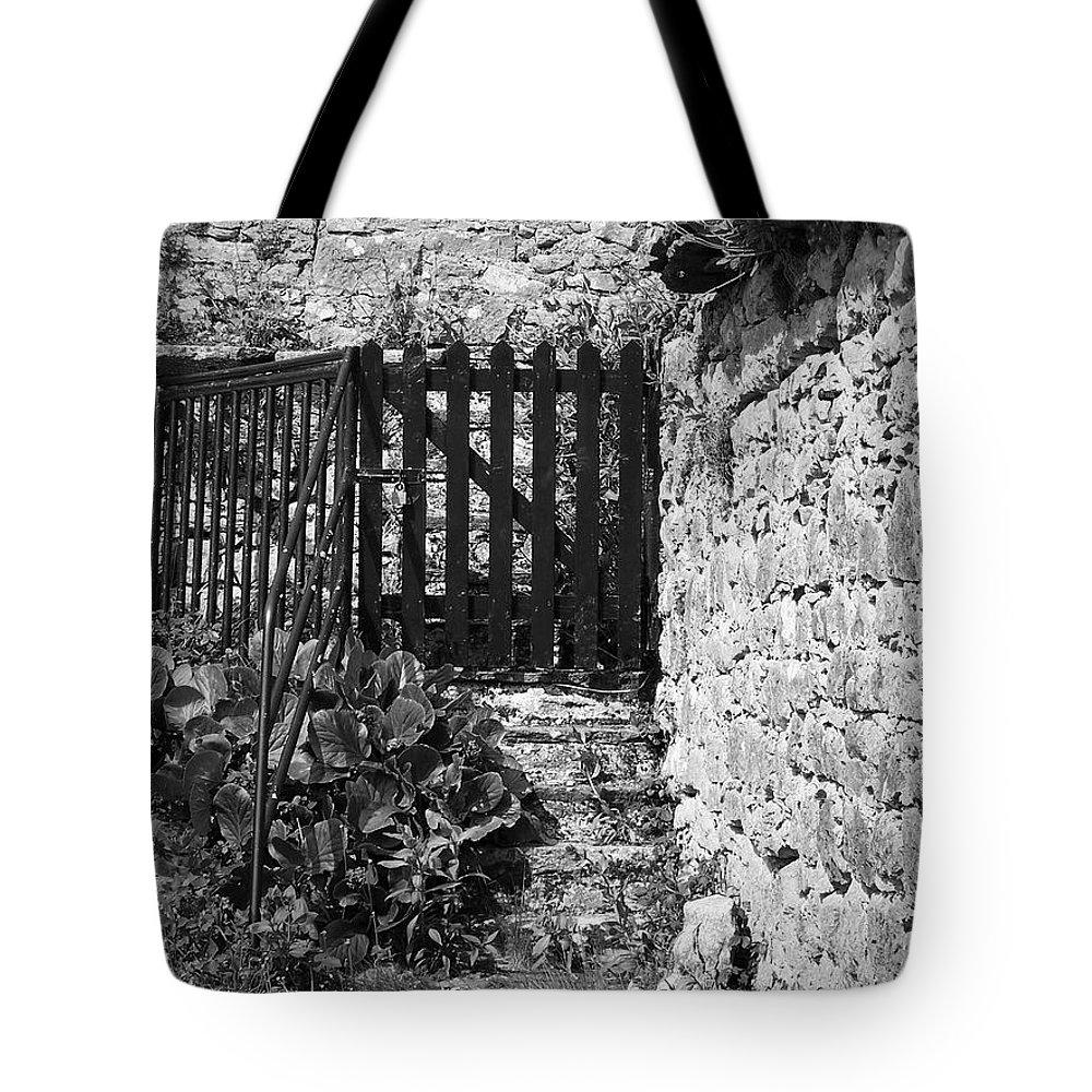 Irish Tote Bag featuring the photograph Gate At Dunguaire Castle Kinvara Ireland by Teresa Mucha
