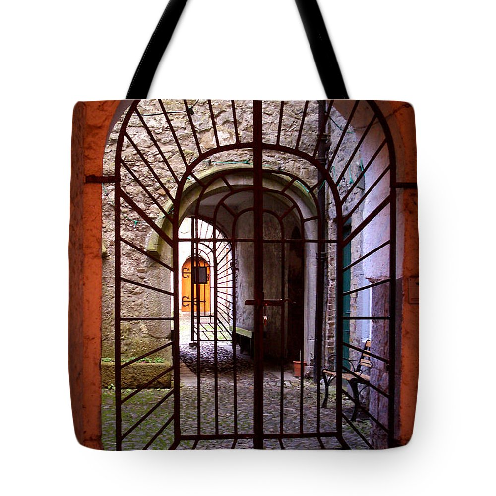 Gate Tote Bag featuring the photograph Gated Passage by Tim Nyberg