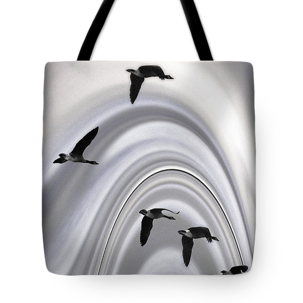 Geese Tote Bag featuring the photograph Geese In A Halo by Wayne King