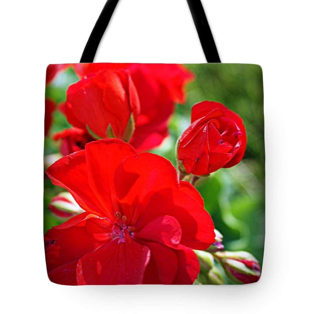 Red Tote Bag featuring the photograph Geraniums by Cricket Hackmann