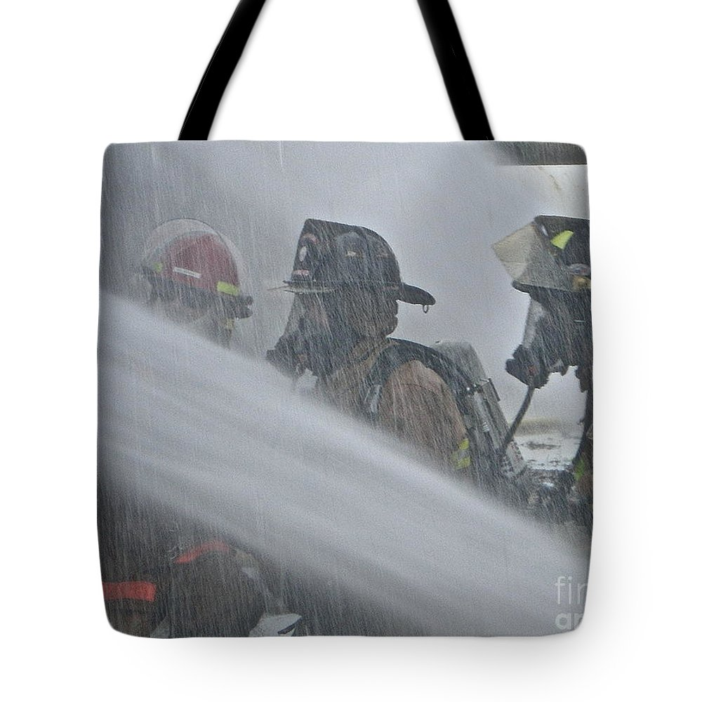 Firefighter Tote Bag featuring the photograph Getting Wet by Rick Monyahan