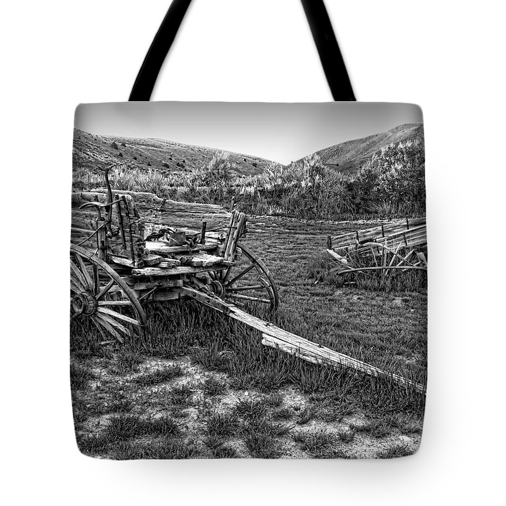 Wagons Tote Bag featuring the photograph Ghost Wagons Of Bannack Montana by Daniel Hagerman