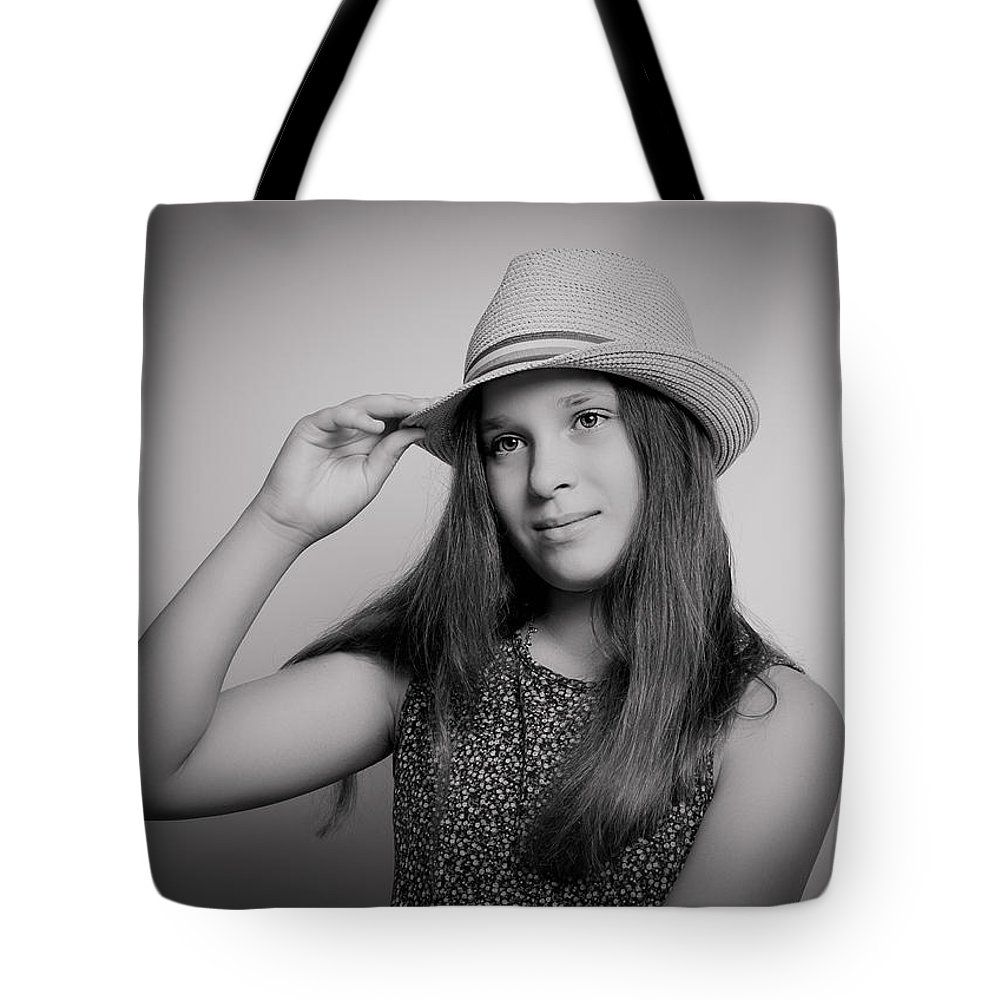 Girl Tote Bag featuring the photograph Girl With Hat by Natalya Antropova