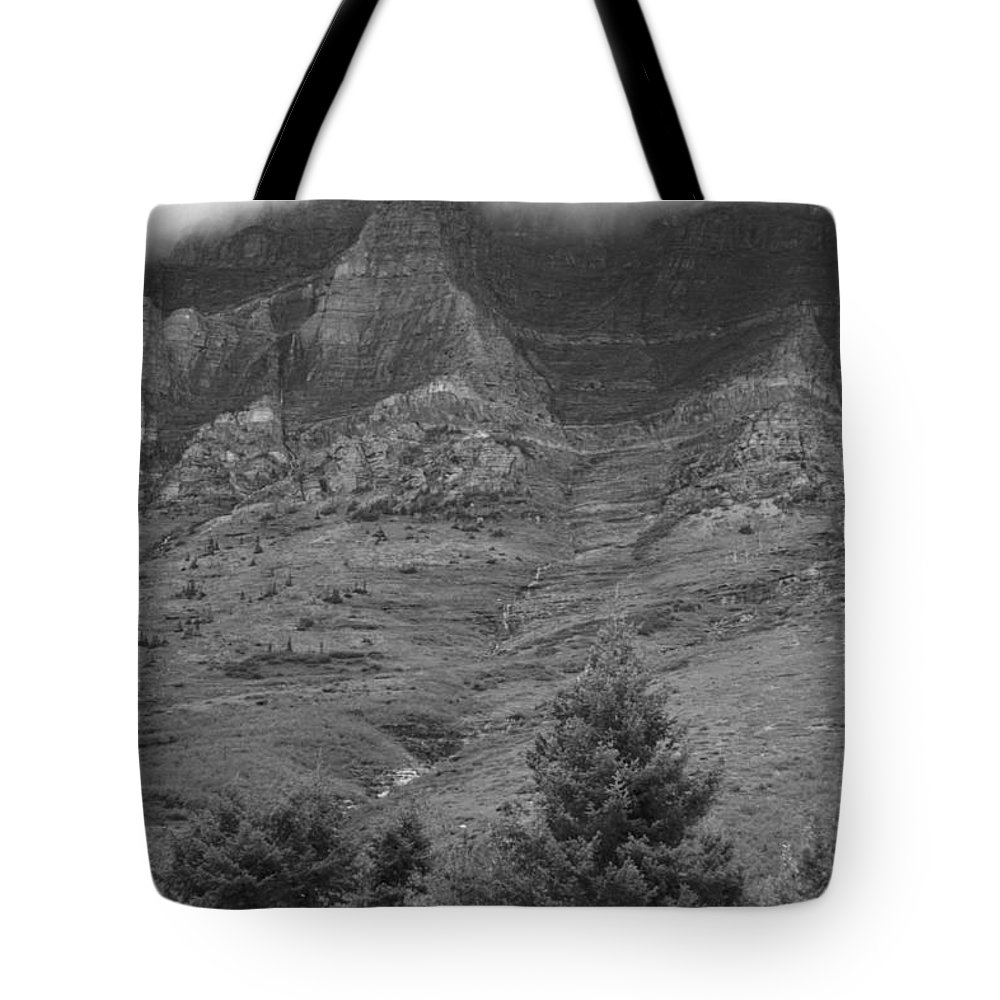 Glacier National Park Montana Horizontal Black And White Mountain Cloud Landscape Striation Pine Tree Waterfall Tote Bag featuring the photograph Glacier National Park Montana Vertical by Heather Kirk