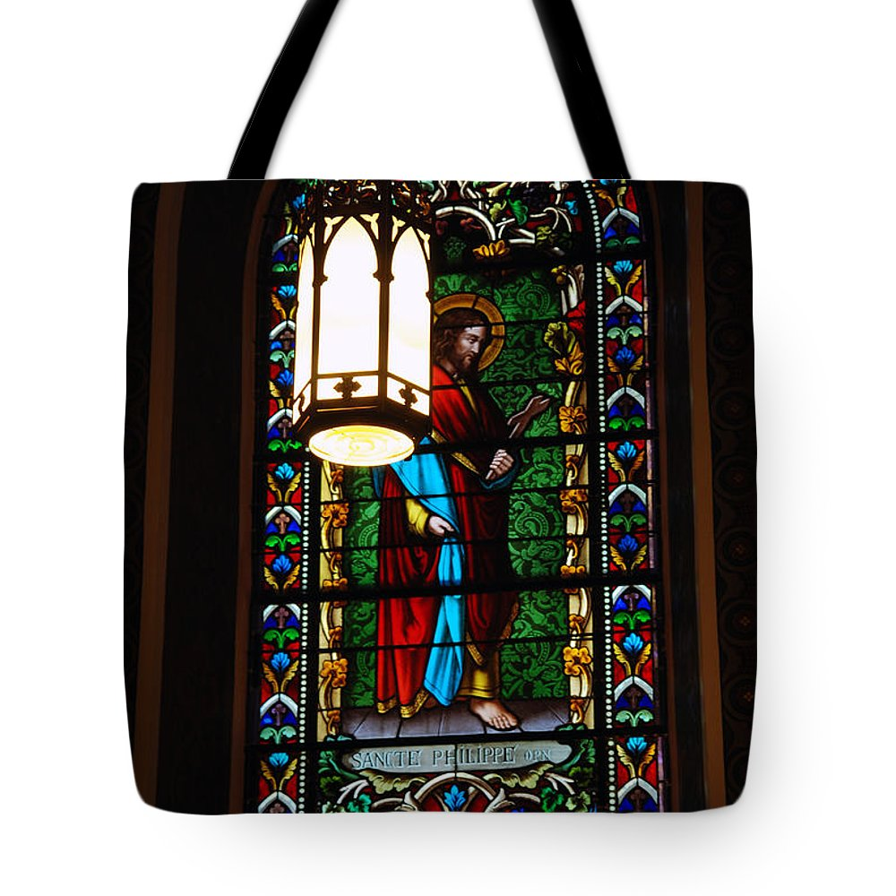Cathedral Basilica In Santa Fe Tote Bag featuring the photograph Glass Window Of Saint Philip In The Basilica In Santa Fe by Susanne Van Hulst
