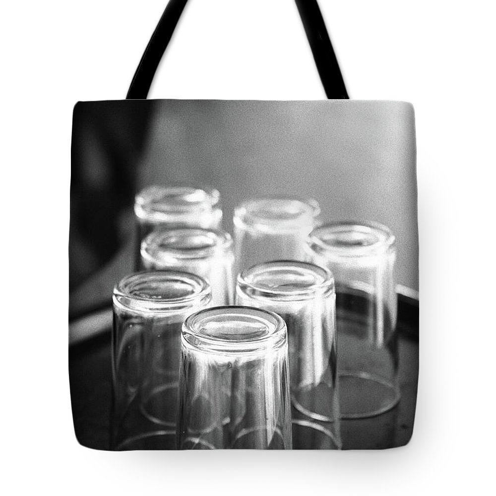 Bar Tote Bag featuring the photograph Glasses In A Bar by Gaspar Avila