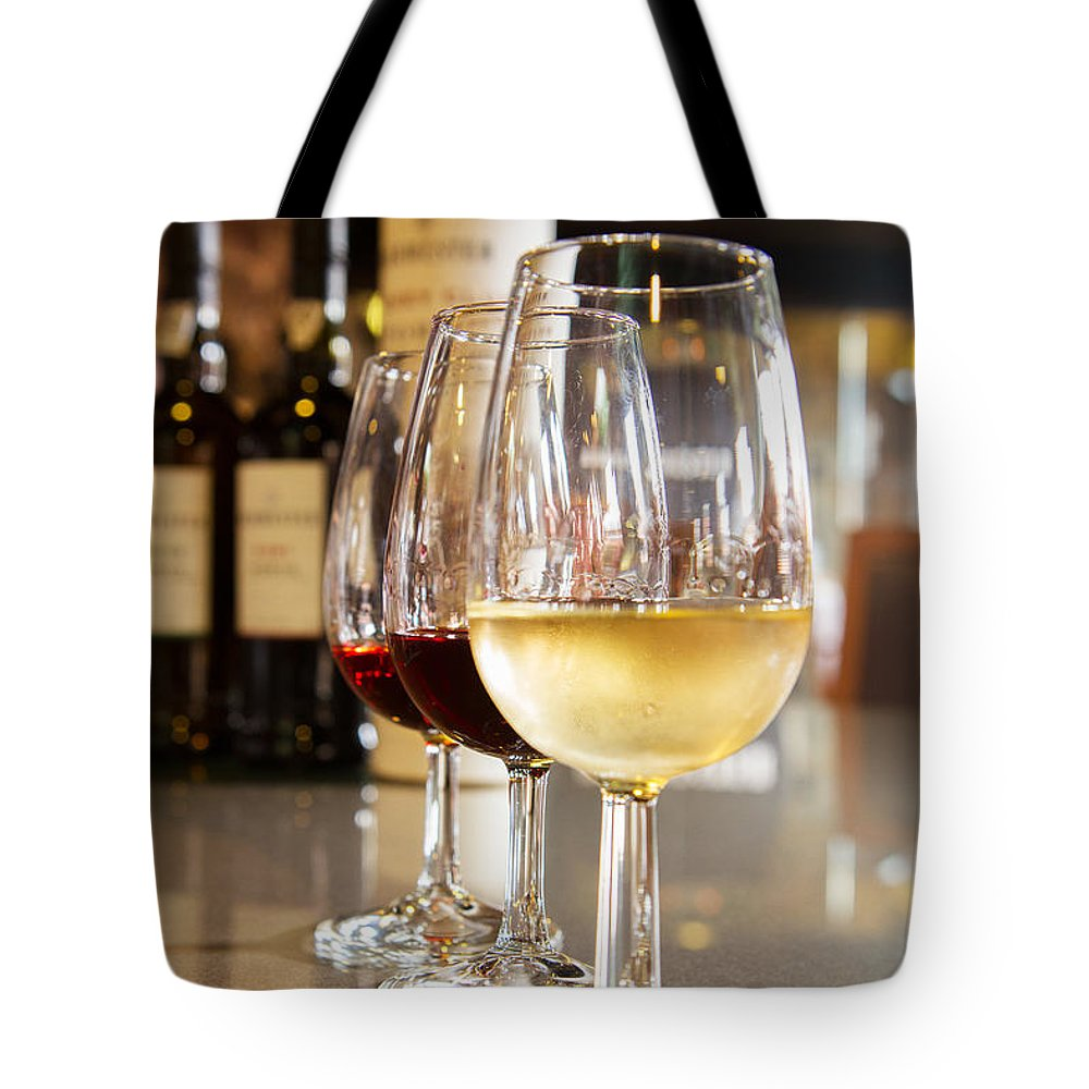 Wine Tote Bag featuring the photograph Glasses Of Port Wine by Anastasy Yarmolovich
