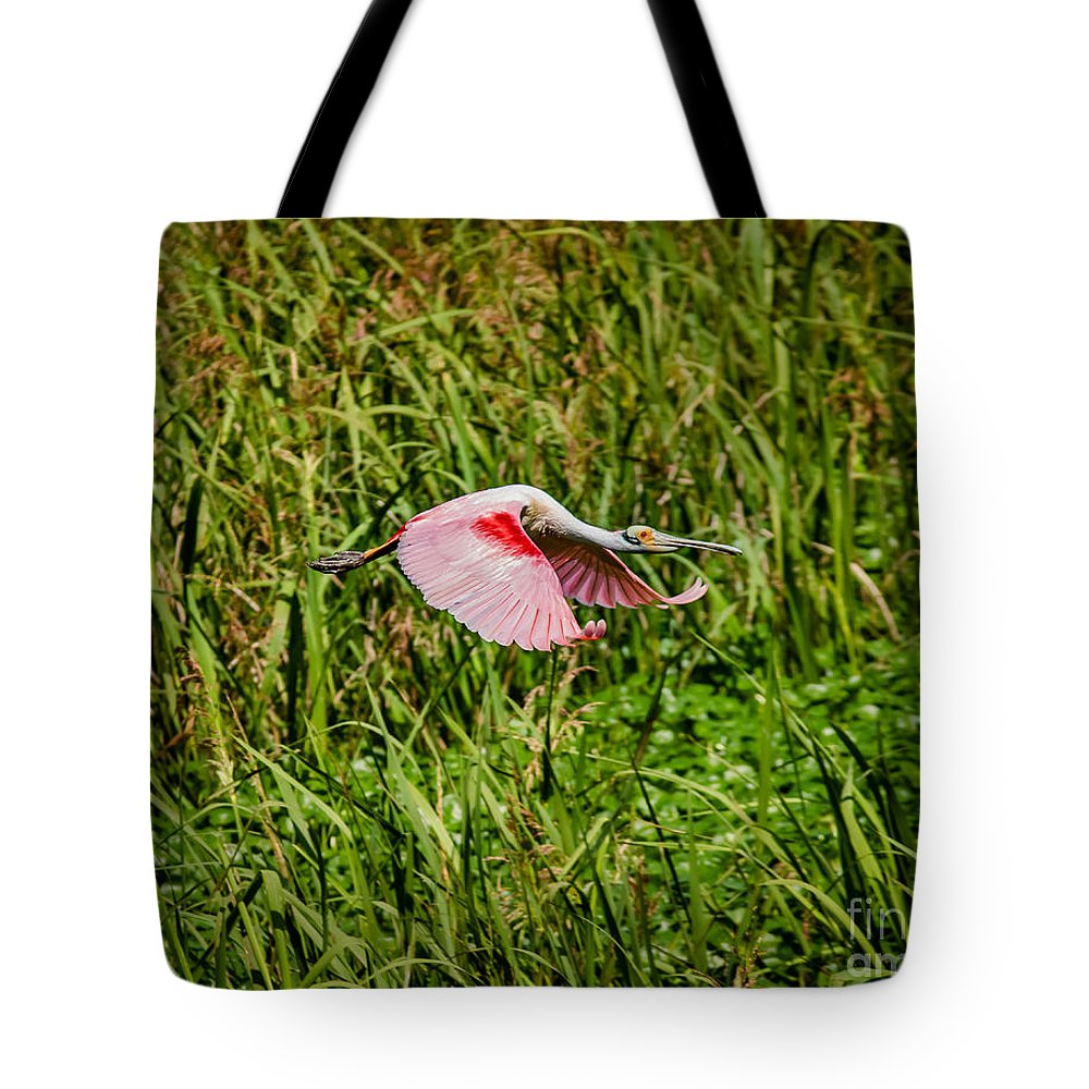 Animal Tote Bag featuring the photograph Gliding Spoonbill In Bayou by Robert Frederick