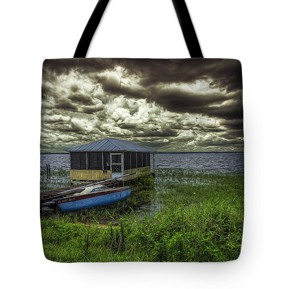 Clouds Tote Bag featuring the photograph Gloomy Day By The Lake by Lewis Mann