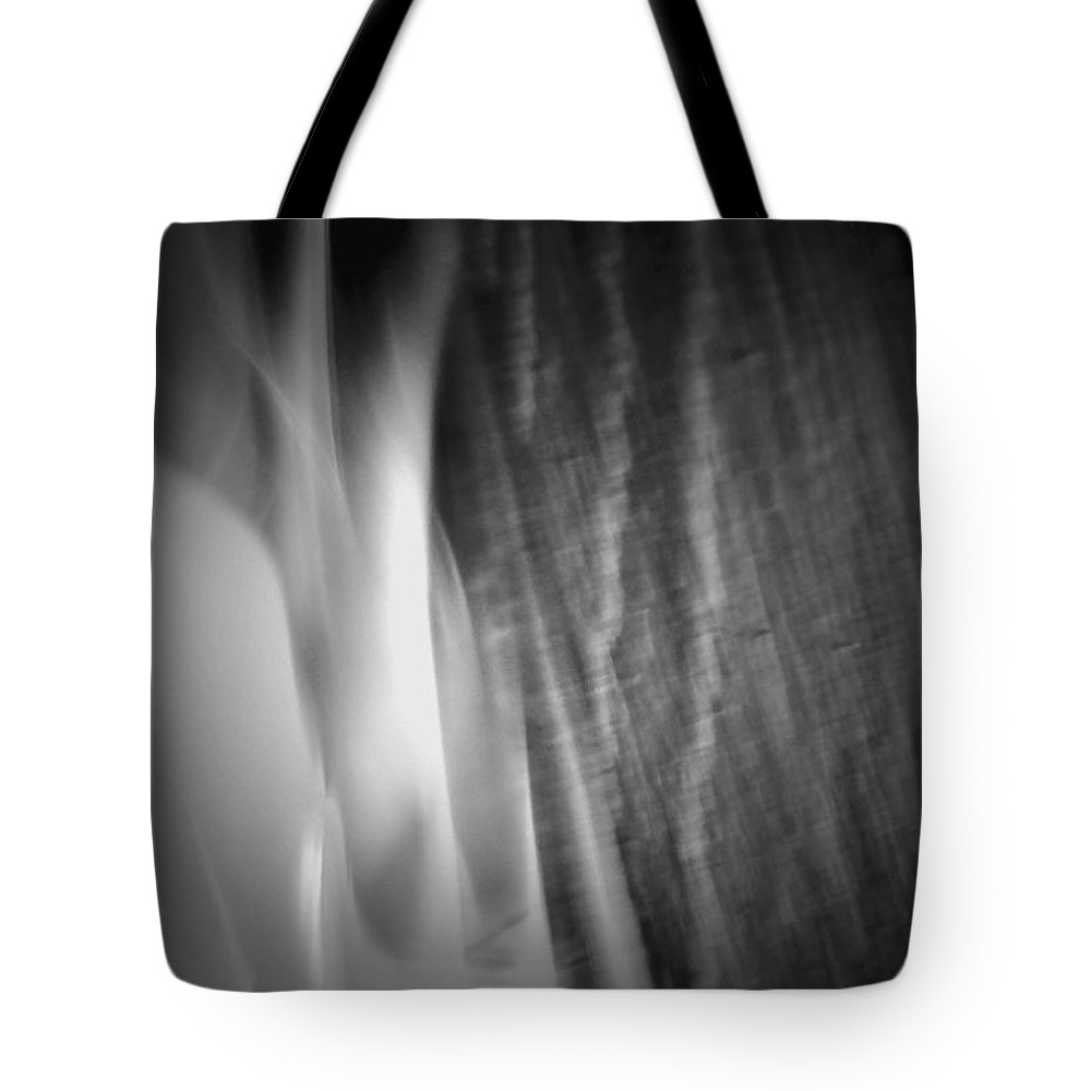 Fire Tote Bag featuring the photograph Glow Of The Flame B N W by Richard Andrews