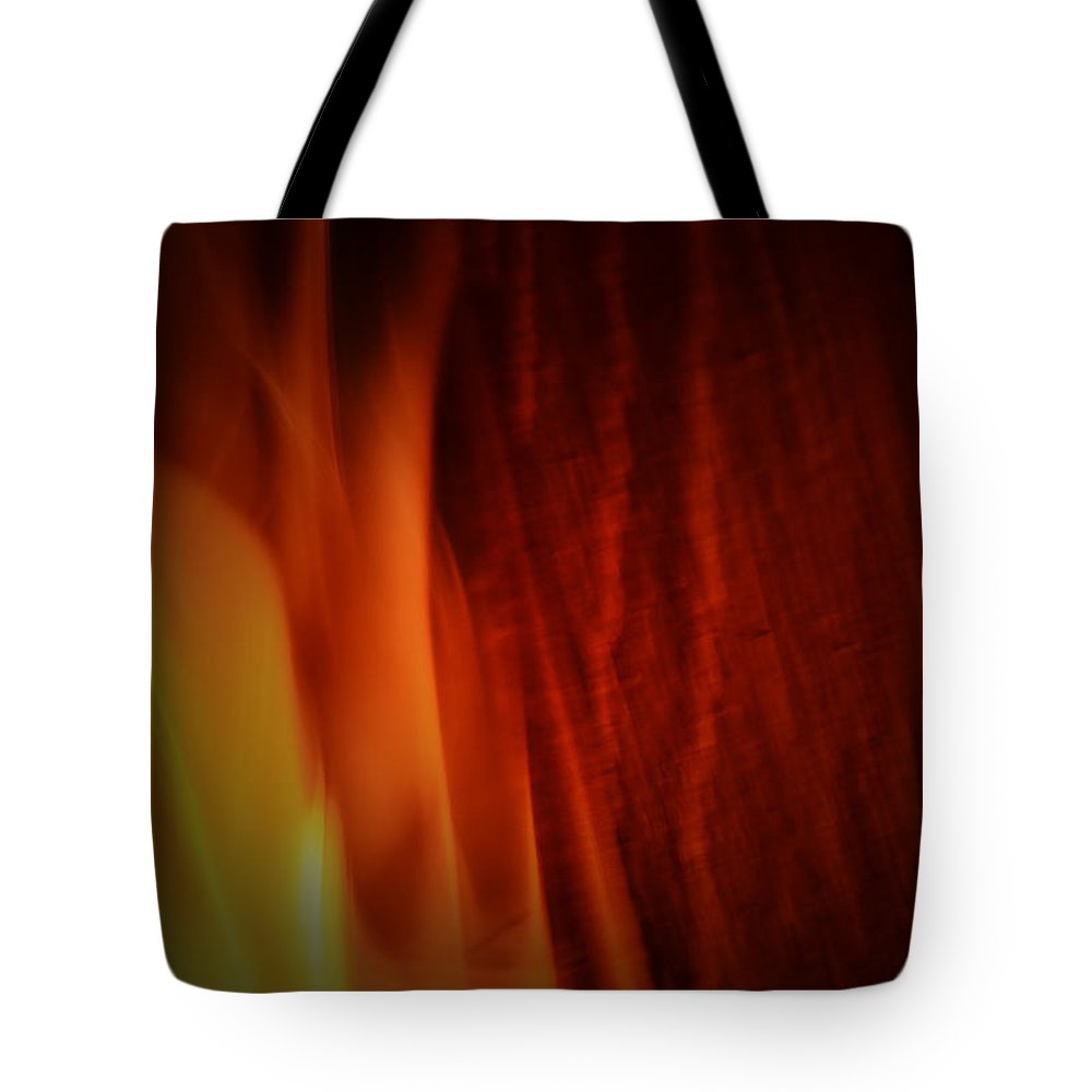 Fire Tote Bag featuring the photograph Glow Of The Flame by Richard Andrews