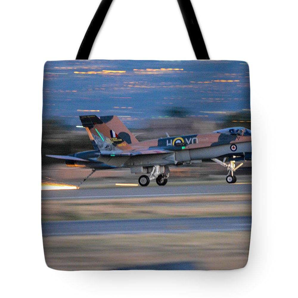 Royal Canadian Air Forces Tote Bag featuring the photograph Glowing Hornet by Tommy Anderson