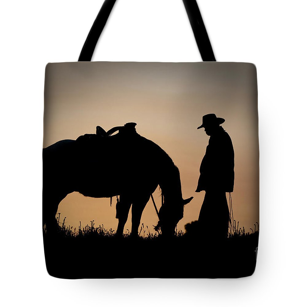 Cowboy And Horse Tote Bag featuring the photograph Going Home by Sandra Bronstein