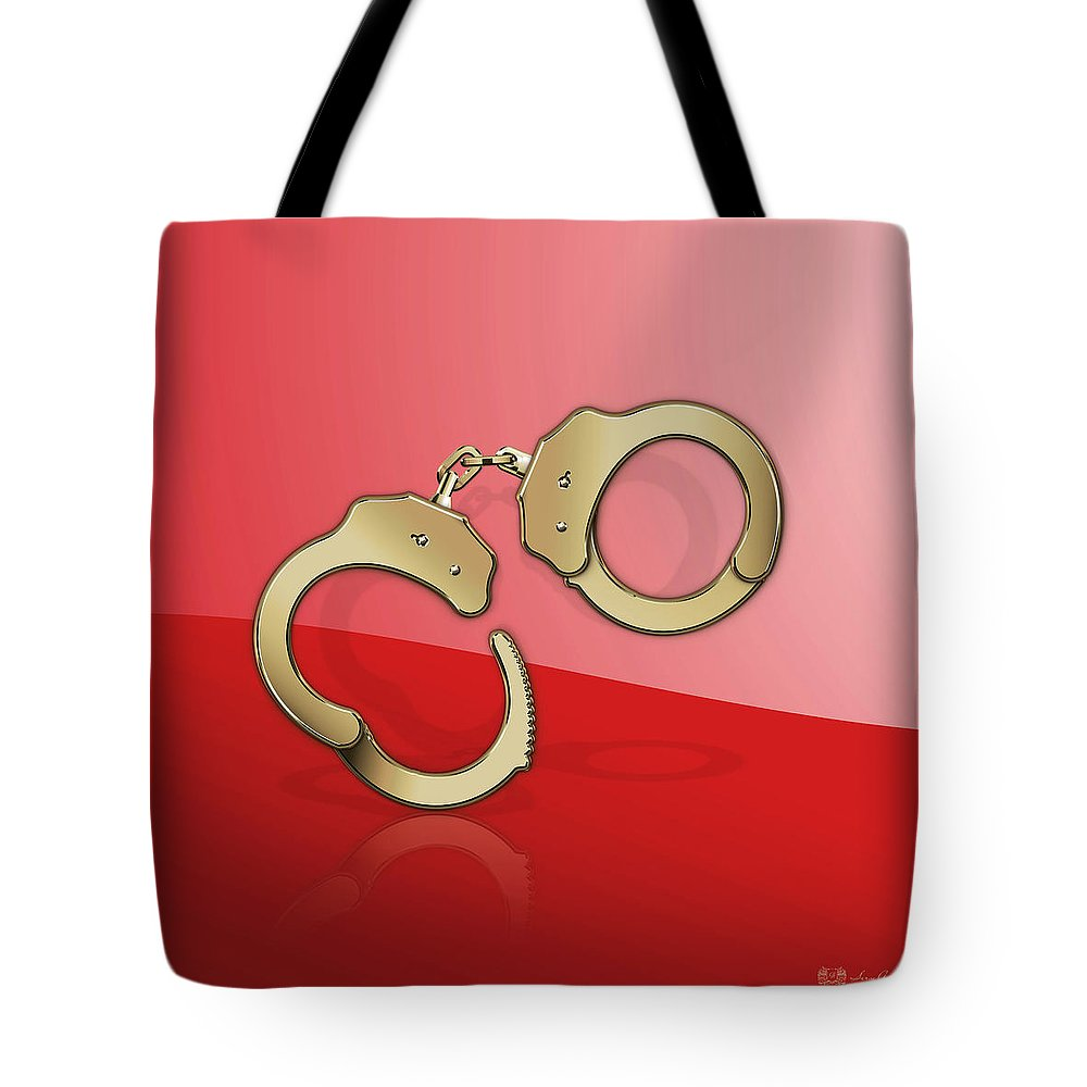 Tools Of The Trade By Serge Averbukh Tote Bag featuring the photograph Gold Handcuffs On Red by Serge Averbukh