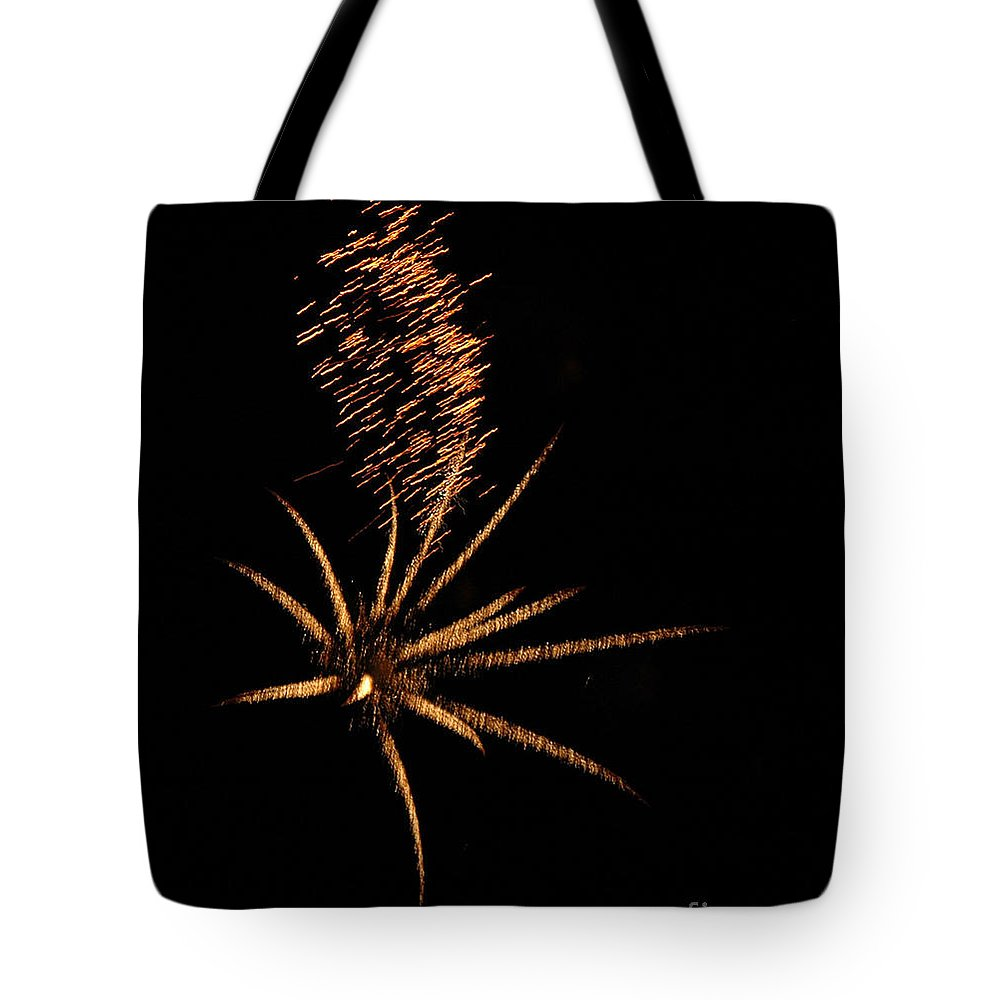 Fireworks Tote Bag featuring the photograph Gold Star Tail by Norman Andrus