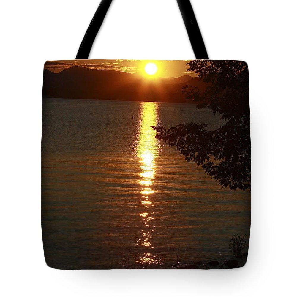 Sunset Tote Bag featuring the photograph Golden Evening Sun Rays by Deborah Benoit