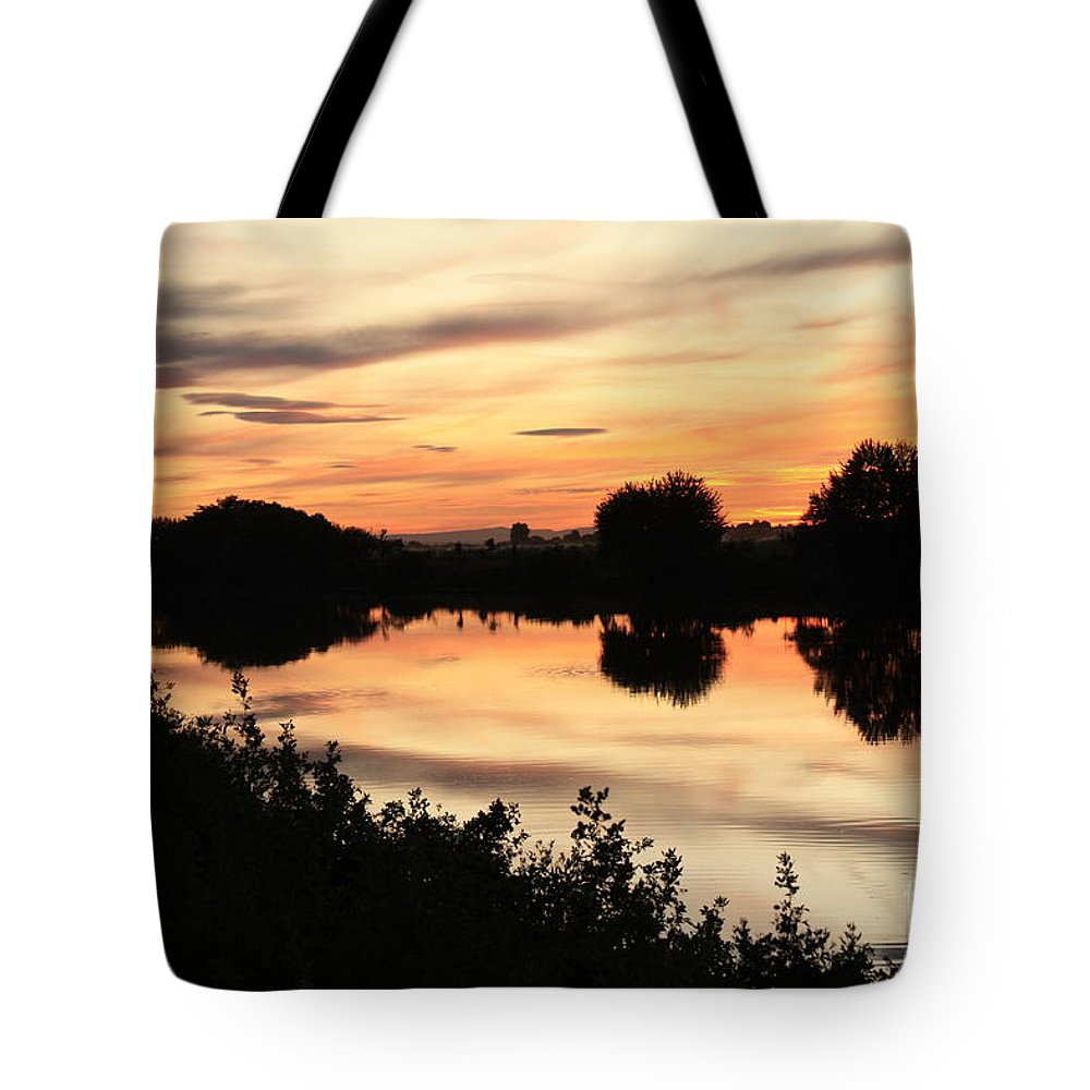 Golden Sunset Tote Bag featuring the photograph Golden Sunset Reflection by Carol Groenen
