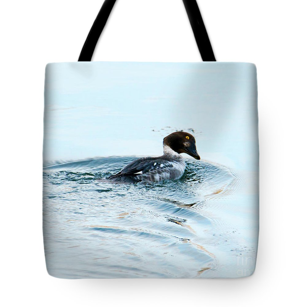 Common Goldeneye Tote Bag featuring the photograph Goldeneye Glance by Mike Dawson