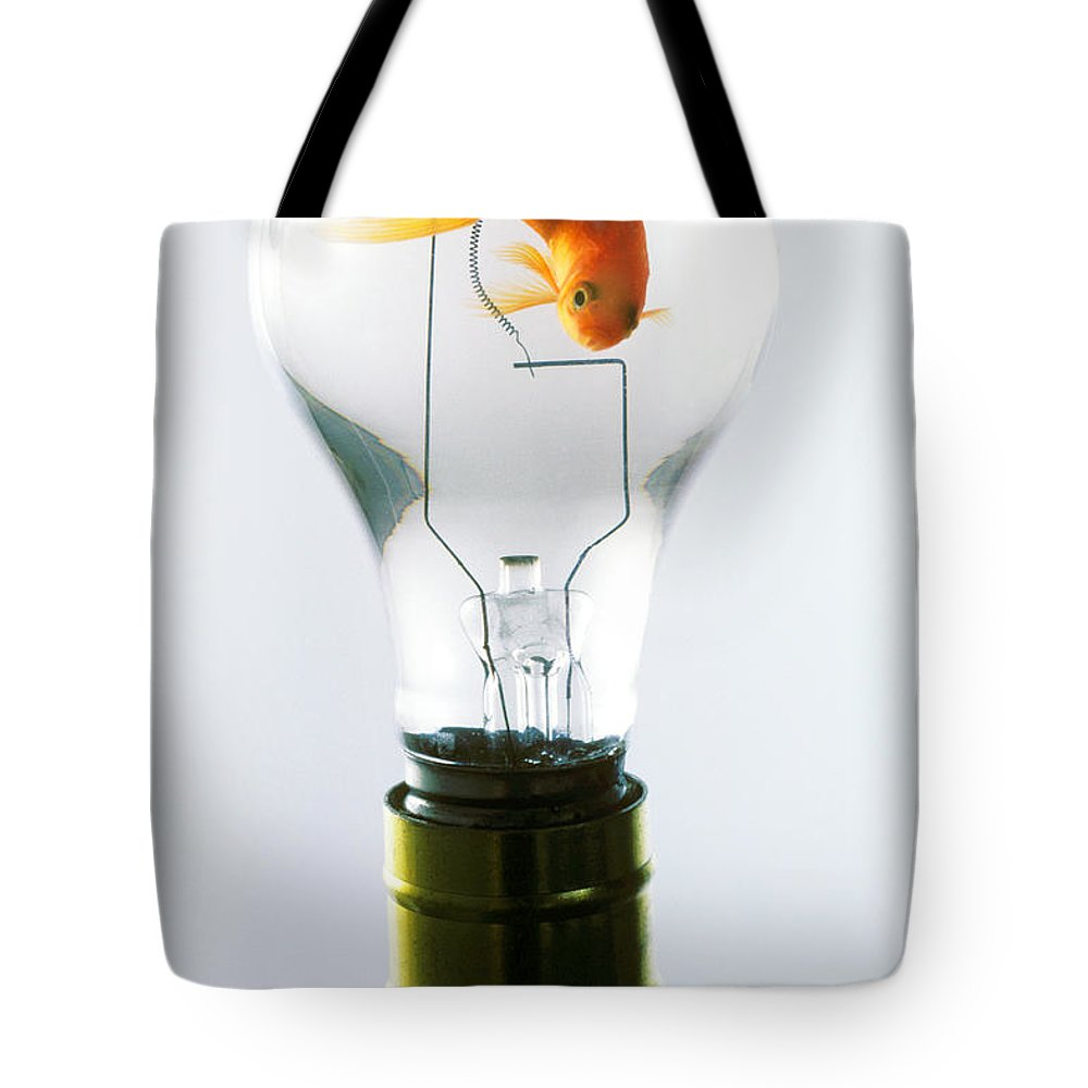 Fish Tote Bag featuring the photograph Goldfish In Light Bulb by Garry Gay