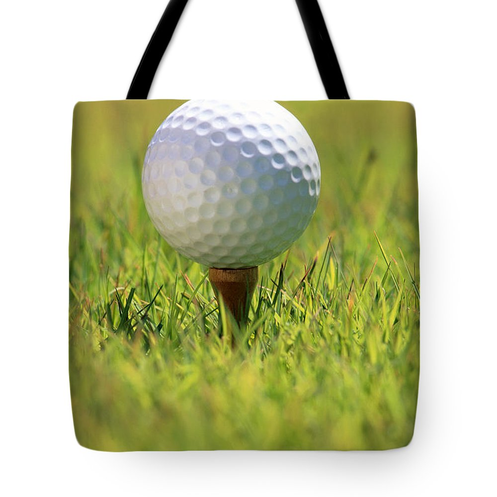 Afternoon Tote Bag featuring the photograph Golf Ball On Tee by Carl Shaneff - Printscapes