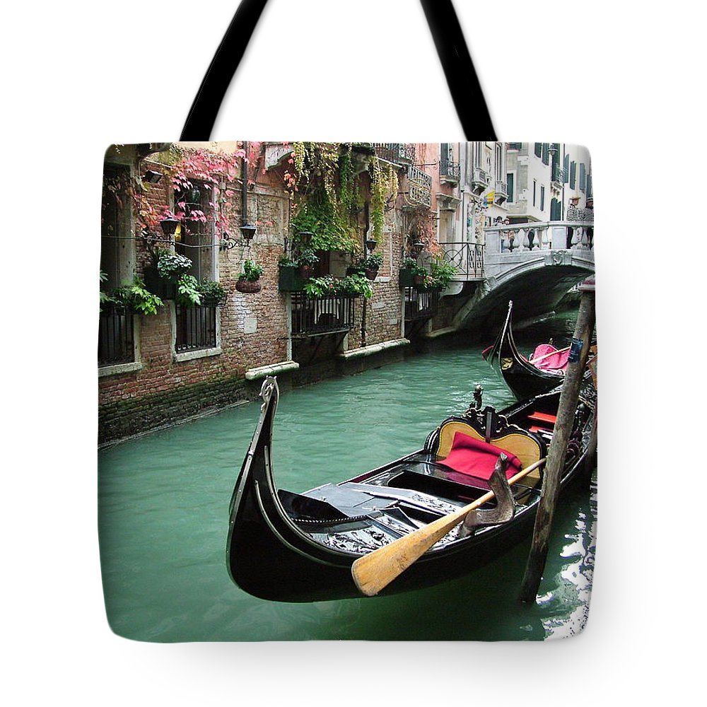 Venice Photos Tote Bag featuring the photograph Gondola By The Restaurant by Donna Corless