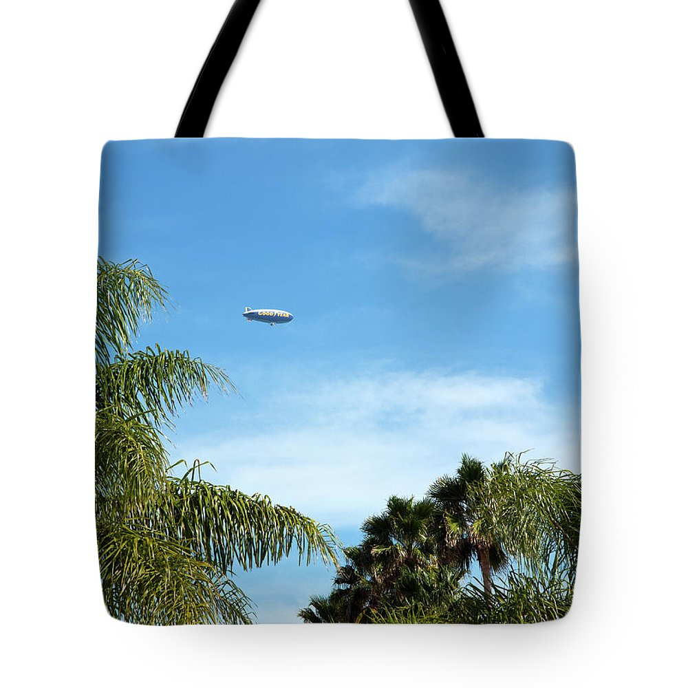 Goodyear Tote Bag featuring the photograph Goodyear Blimp Spirit Of Innovation In Florida by Allan Hughes
