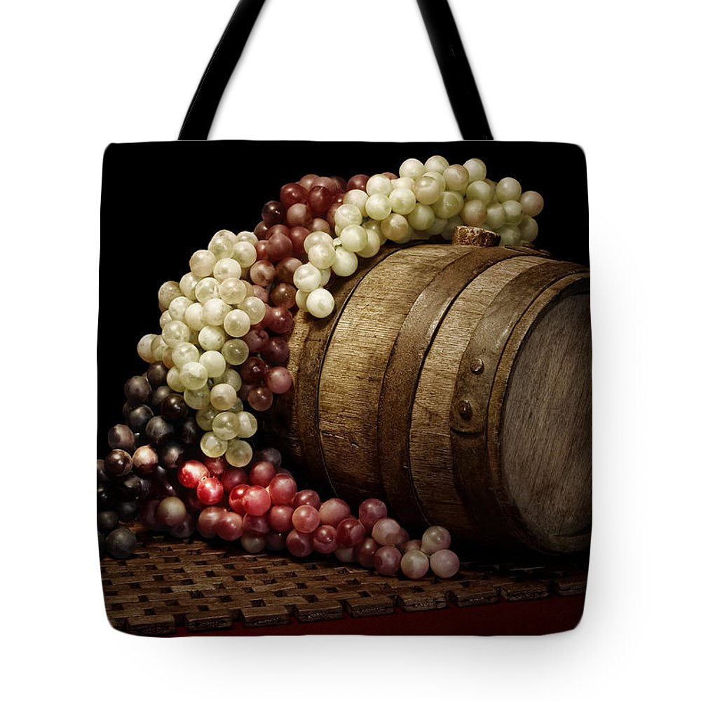 Art Tote Bag featuring the photograph Grapes And Wine Barrel by Tom Mc Nemar