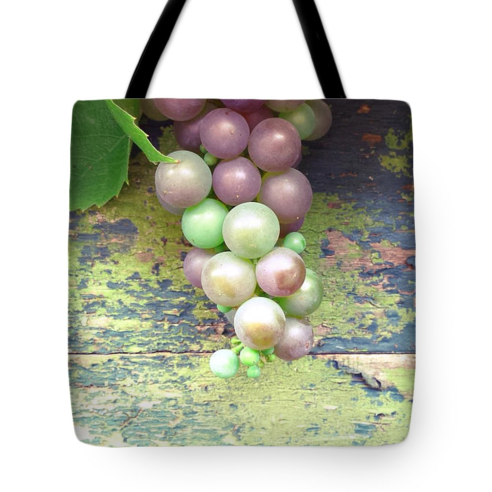 Grapes Tote Bag featuring the photograph Grapes On Fence by Beril Sirmacek