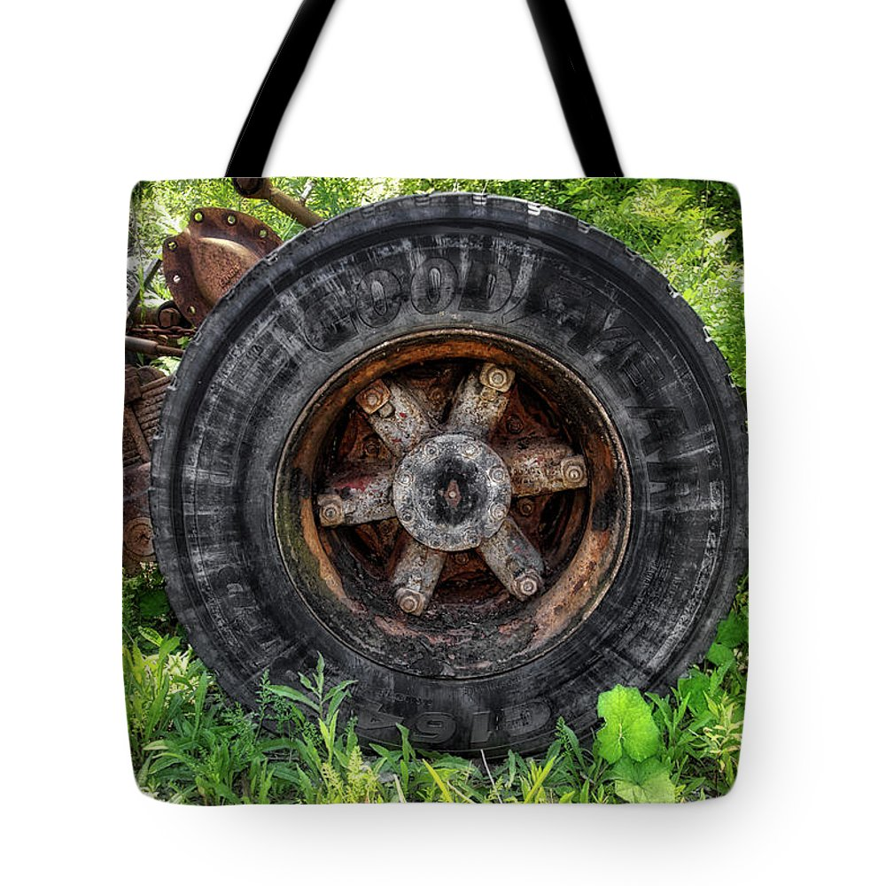 Gravel Pit Tote Bag featuring the photograph Gravel Pit Goodyear Truck Tire by Thomas Woolworth
