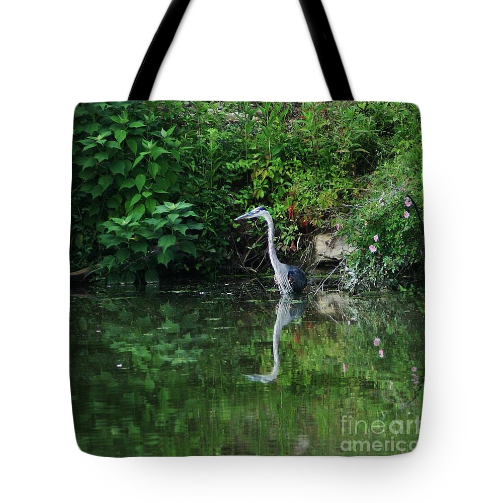 Lanscape Water Bird Crane Heron Blue Green Flowers Great Photograph Tote Bag featuring the photograph Great Blue Heron Hunting Fish by Dawn Downour