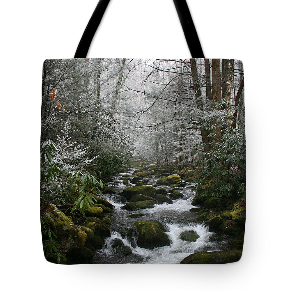 Green Snow Tree Trees Winter Stream River Creek Water Stone Rock Flow Boulder Forest Woods Cold Tote Bag featuring the photograph Green And White by Andrei Shliakhau