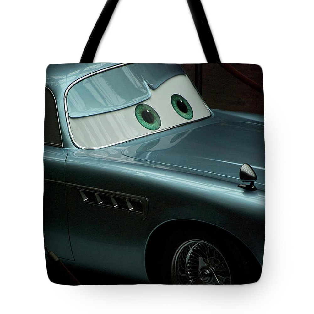 Finn Mcmissile Tote Bag featuring the photograph Green Eyed Finn McMissile MP by Thomas Woolworth