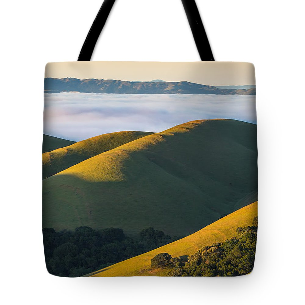 Landscape Tote Bag featuring the photograph Green Hills And Low Clouds by Marc Crumpler