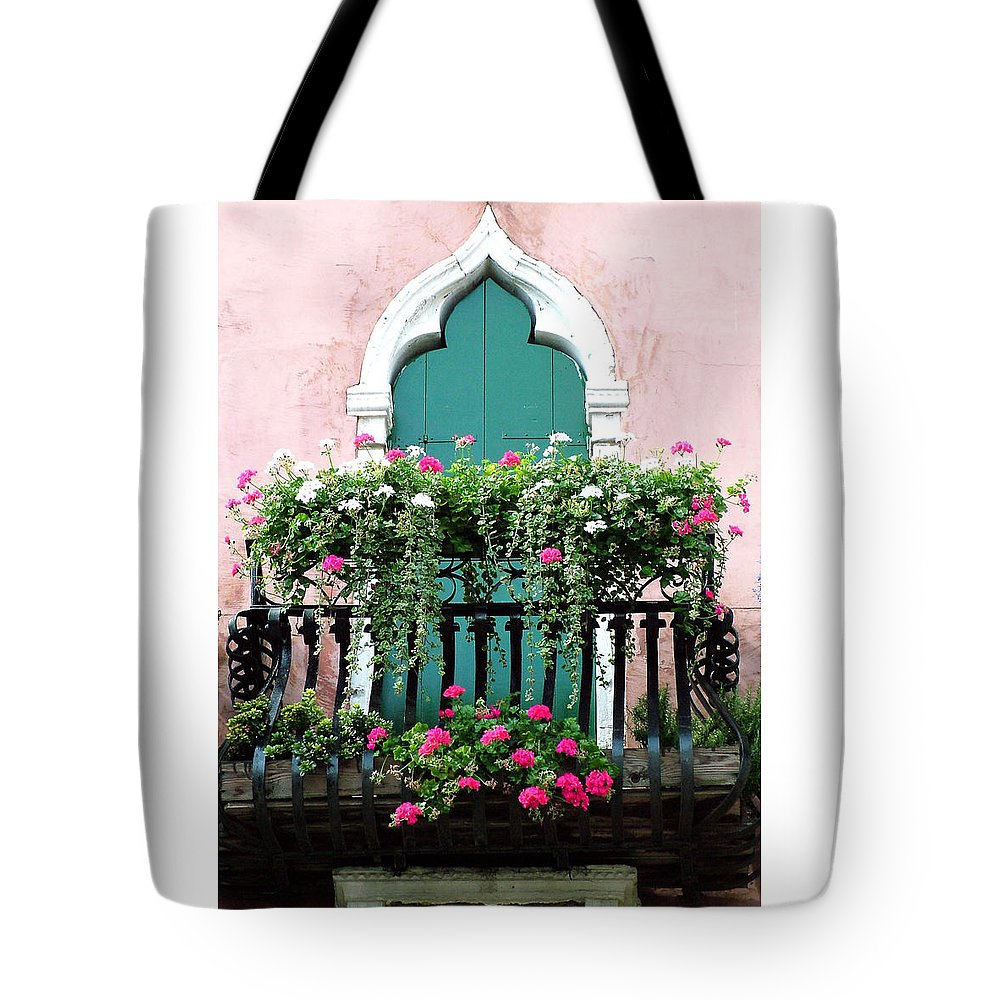 Green Tote Bag featuring the photograph Green Ornate Door With Geraniums by Donna Corless