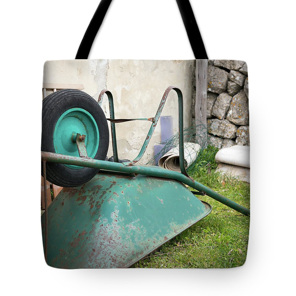 Cres Tote Bag featuring the photograph Green Wheelbarrow Lying On A Green Meadow by Stefan Rotter
