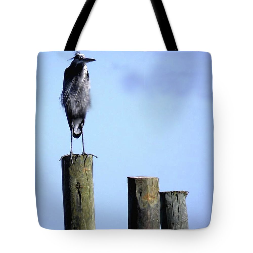 Birds Tote Bag featuring the photograph Grey Heron On A Pole by Angelcia Wright