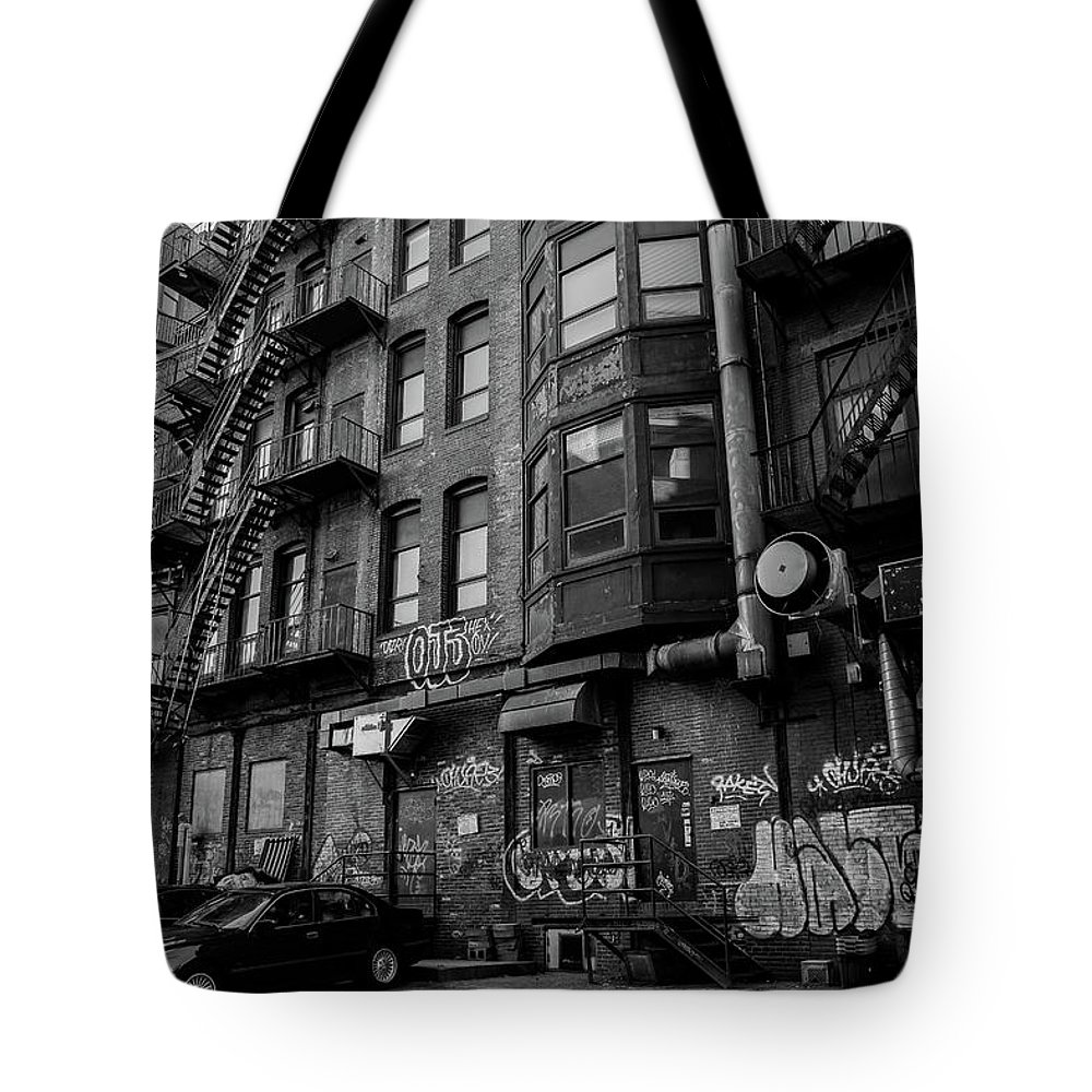 Alley Tote Bag featuring the photograph Gritty by John Gagnon