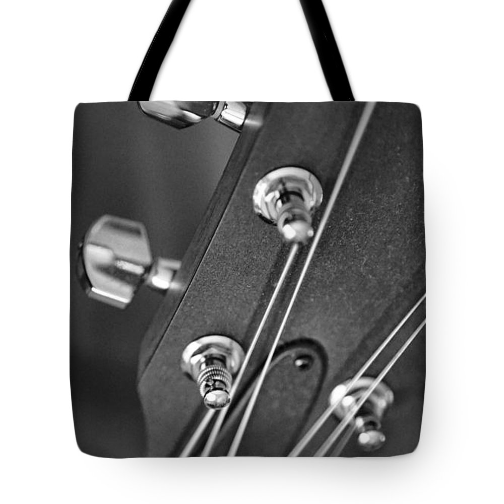 Still Life Tote Bag featuring the photograph Guitar Study A by Anthony Ackerman