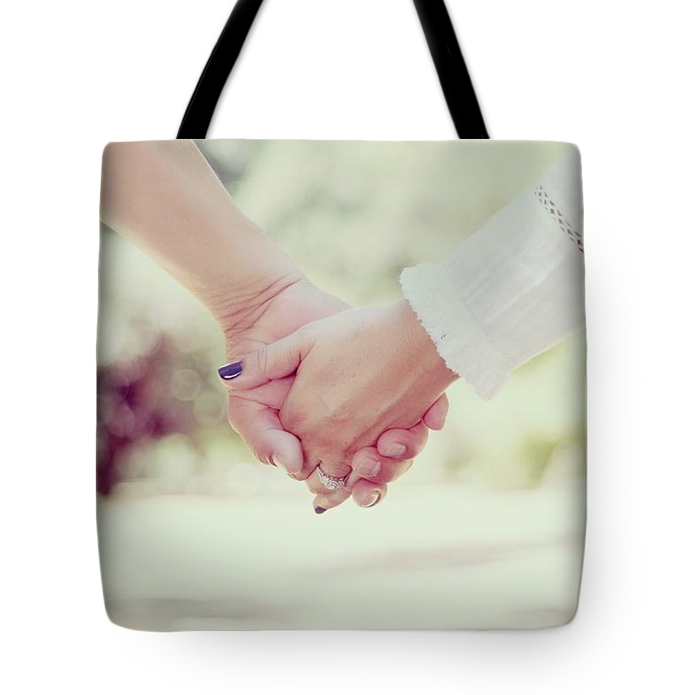 Love Tote Bag featuring the photograph Hand In Hand by Sandy Sheni