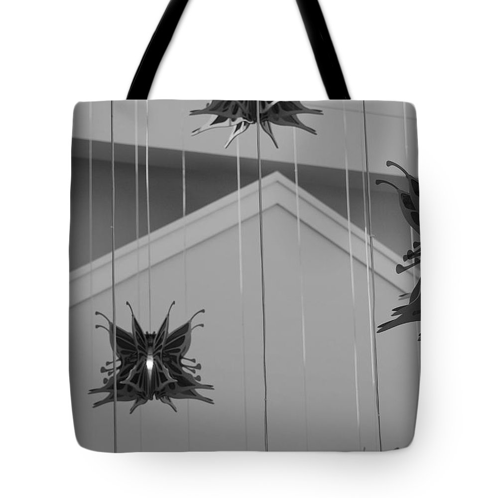 Architecture Tote Bag featuring the photograph Hanging Butterflies by Rob Hans