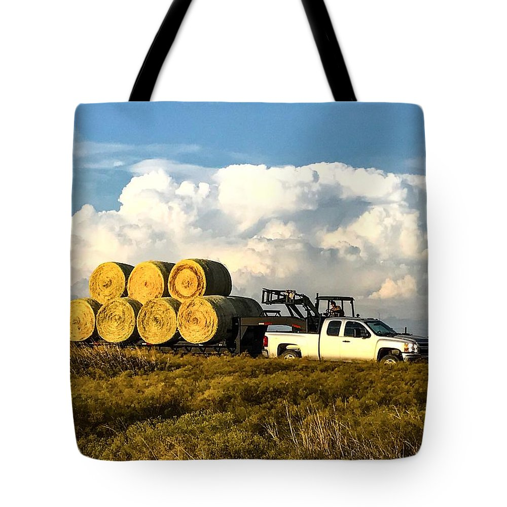 Hay Tote Bag featuring the photograph Hauling Hay Bales by Jeanie Mann