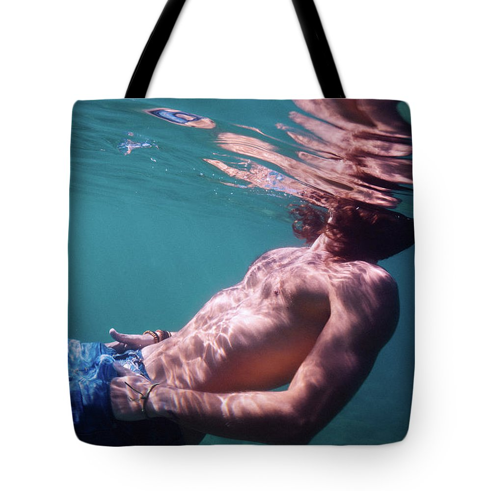 Swim Tote Bag featuring the photograph He by Gemma Silvestre
