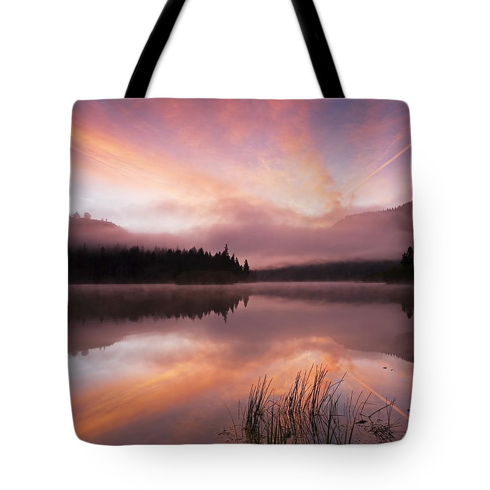 Sunrise Tote Bag featuring the photograph Heavenly Skies by Mike Dawson