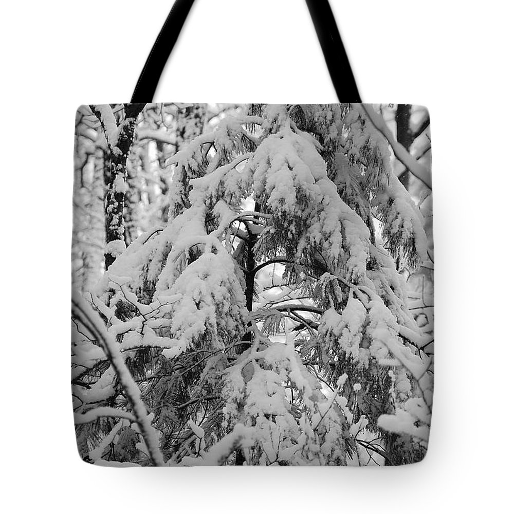Snow Tote Bag featuring the photograph Heavy Burden by Eric Liller