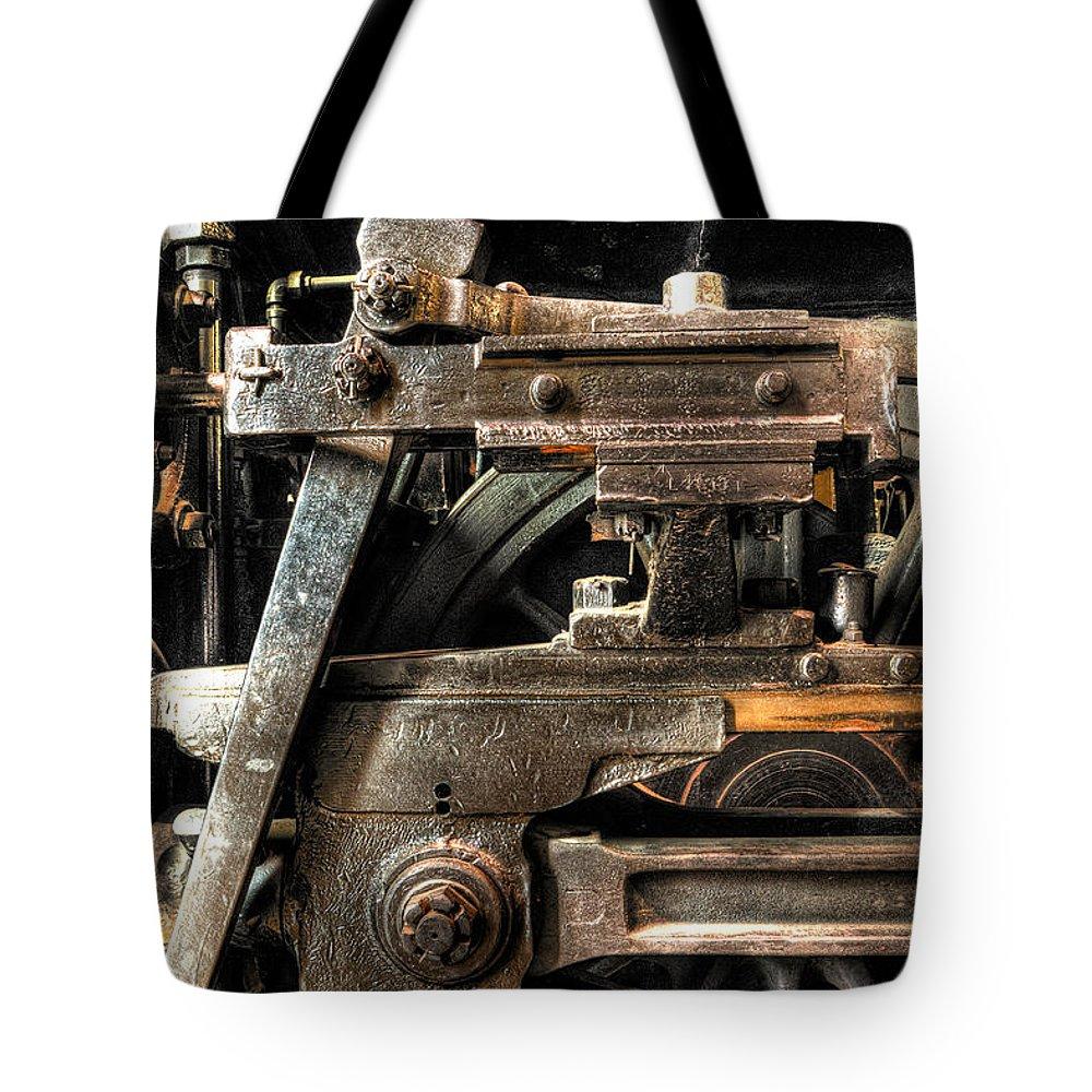 Train Tote Bag featuring the photograph Heavy Wheel by Scott Wyatt