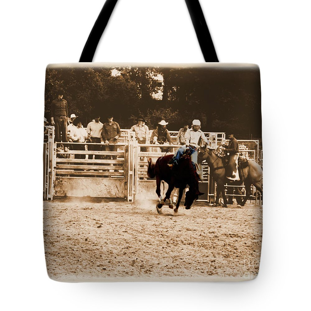 Sepia Tote Bag featuring the photograph Helluva Rodeo-the Ride 2 by September Stone